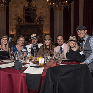 Las Vegas Murder Mystery party guests at the table