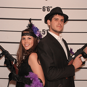 Las Vegas Murder Mystery party guests pose for mugshots